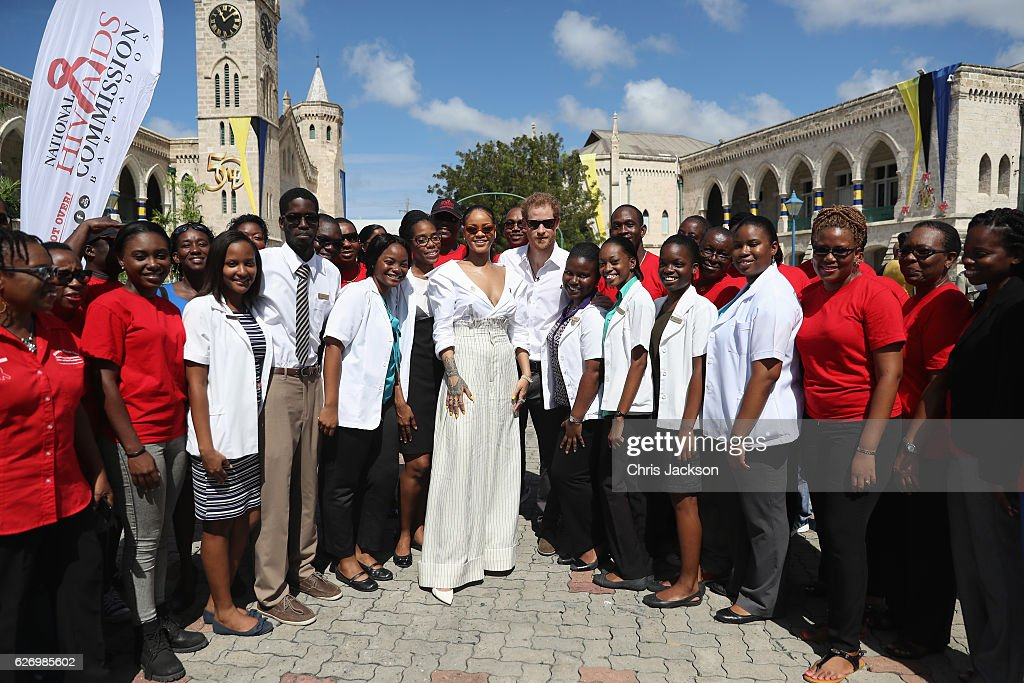 Rihanna and Prince Harry pose with volunteers at the 'Man Aware' event held by the Barbados National HIV/AIDS Commission on the eleventh day of an official visit on December 1, 2016 in Bridgetown, Barbados. Prince Harry's visit to The Caribbean marks the 35th Anniversary of Independence in Antigua and Barbuda and the 50th Anniversary of Independence in Barbados and Guyana.