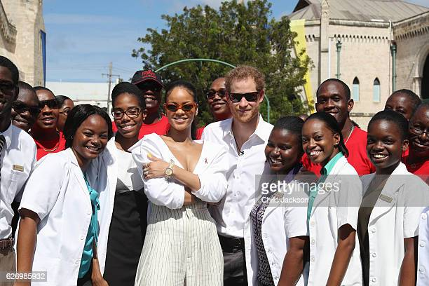 Rihanna and Prince Harry pose with volunteers at the 'Man Aware' event held by the Barbados National HIV/AIDS Commission on the eleventh day of an...