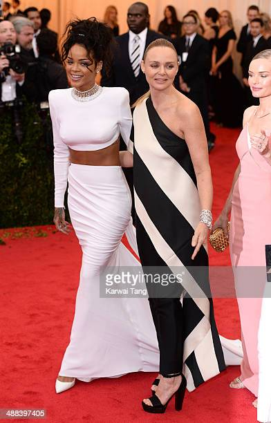 Rihanna and Stella McCartney attend the 'Charles James Beyond Fashion' Costume Institute Gala held at the Metropolitan Museum of Art on May 5 2014 in...