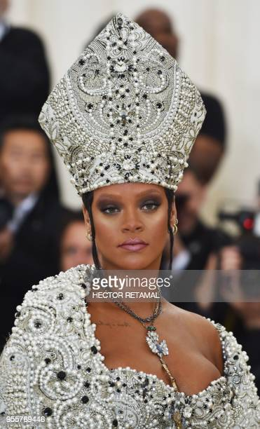 TOPSHOT Rihanna arrives for the 2018 Met Gala on May 7 at the Metropolitan Museum of Art in New York The Gala raises money for the Metropolitan...