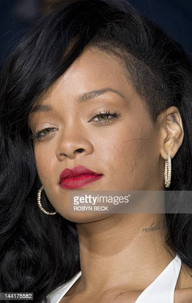 Rihanna arrives for the premiere of Battleship May 2012 at the NOKIA Theatre at LA LIVE in downtown Los Angeles AFP PHOTO / ROBYN BECK