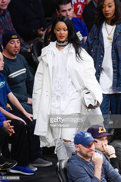 Rihanna attends a basketball game between the Golden State Warriors and the Los Angeles Lakers at Staples Center on March 6 2016 in Los Angeles...