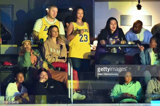 Rihanna attends a basketball game between the Los Angeles Lakers and the Houston Rockets at Staples Center on February 21 2019 in Los Angeles...