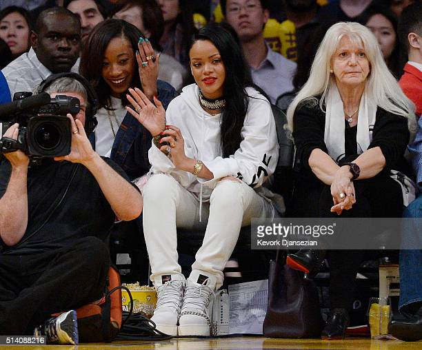 Rihanna attends a basketball game between the Los Angeles Lakers and the Golden State Warriors at Staples Center March 6 in Los Angeles California...