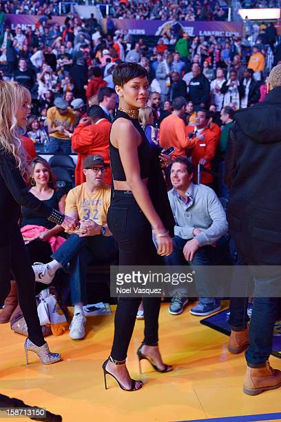 Rihanna attends a basketball game between the New York Knicks and the Los Angeles Lakers at Staples Center on December 25 2012 in Los Angeles...