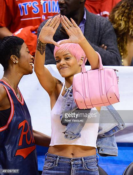 Rihanna attends an NBA playoff game between the Oklahoma City Thunder and the Los Angeles Clippers at Staples Center on May 15 2014 in Los Angeles...