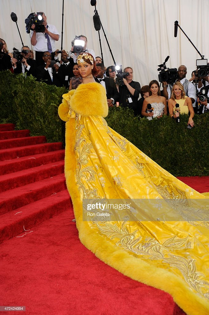 """Rhianna - China: Through the Looking Glass: It was worth the hour wait at the end of the red carpet to see Rhianna appear in a hand-made Chinese couture cape and gown made by Chinese designer, Guo Pei."" - Ron Galella 