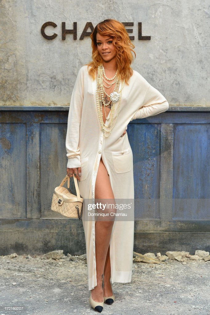 Rihanna attends the Chanel show as part of Paris Fashion Week Haute Couture Fall/Winter 2013-2014 at Grand Palais on July 2, 2013 in Paris, France.