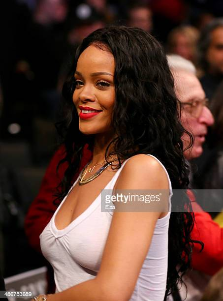 Rihanna attends the game between the Brooklyn Nets and the Toronto Raptors in Game Three of the Eastern Conference Quarterfinals during the 2014 NBA...