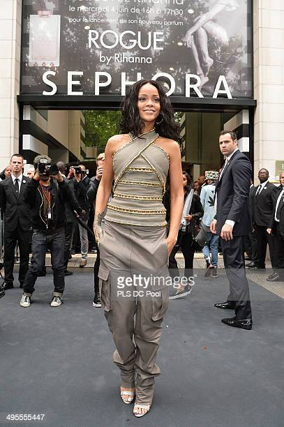 Rihanna attends the 'Rogue by Rihanna' launch at Sephora Champs-Elysees on June 4, 2014 in Paris, France.