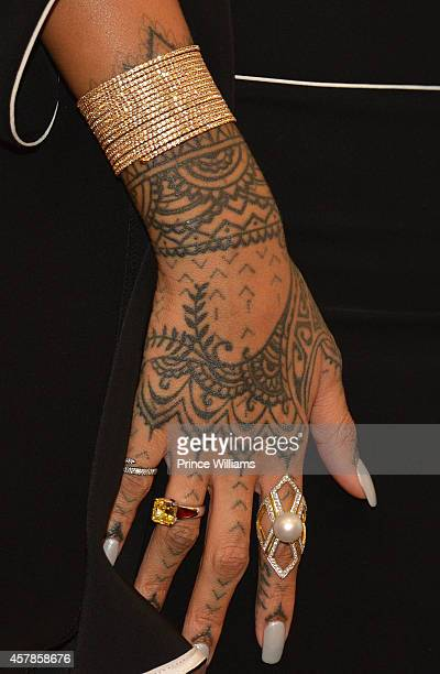 Rihanna attends the Rogue Man By Rihanna Fragrance Launch at Macy's Lenox Square on October 25 2014 in Atlanta Georgia