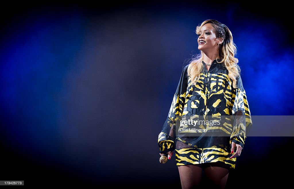 Rhianna attends/performs at Day 2 of the T in the Park festival at Balado on July 13, 2013 in Kinross, Scotland.