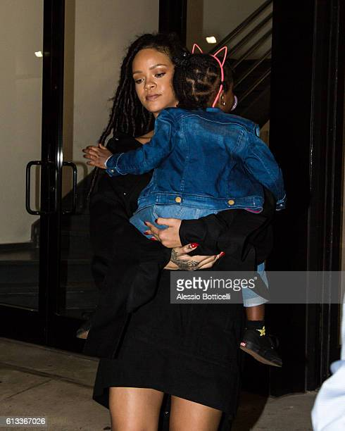Rihanna carries her cousin Majesty as they head to Paint Box nail salon in SoHo on October 7 2016 in New York New York