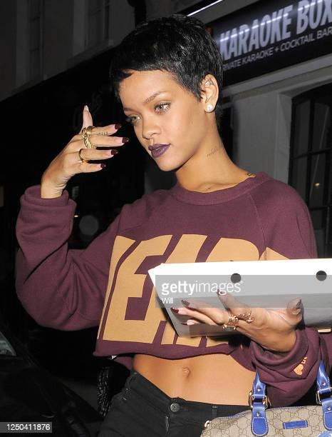 Rihanna carrying a pizza box leaves an art gallery and a tattoo studio after she spent the afternoon with friends on September 8 2012 in London...