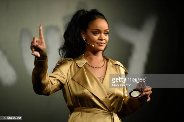 Rihanna gestures on stage during her Fenty Beauty talk in collaboration with Sephora for the launch of her new Stunna Lip paint 'Uninvited' on...