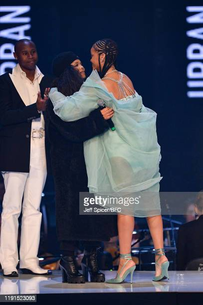 Rihanna hugs Janet Jackson on stage during The Fashion Awards 2019 held at Royal Albert Hall on December 02, 2019 in London, England.