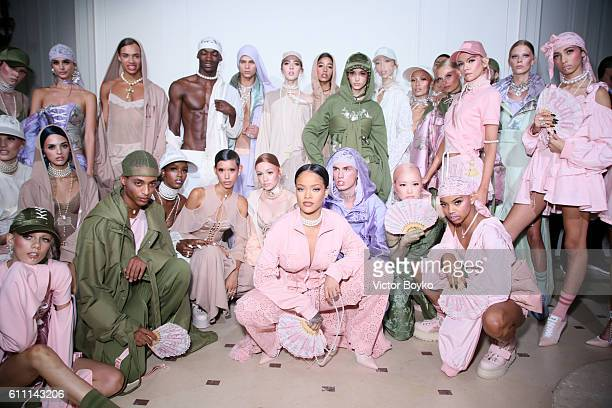 Rihanna is seen with models backstage during FENTY x PUMA by Rihanna at Hotel Salomon de Rothschild on September 28, 2016 in Paris, France.