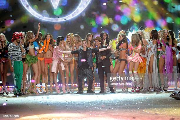 Rihanna Justin Bieber Bruno Mars and models onstage during the 2012 Victoria's Secret Fashion Show at the Lexington Avenue Armory on November 7 2012...