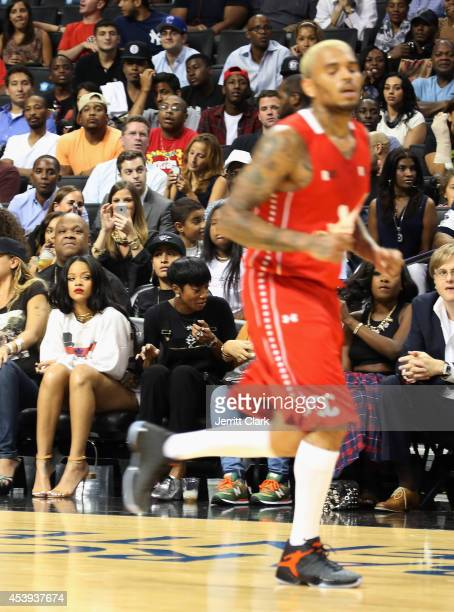 Rihanna looks on as Chris Brown plays in the 2014 Summer Classic Charity Basketball Game at Barclays Center on August 21 2014 in New York City