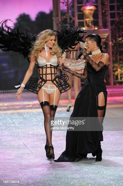 Rihanna performs while Victoria's Secret Angel Doutzen Kroes walks the runway during the 2012 Victoria's Secret Fashion Show at the Lexington Avenue...