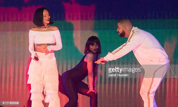 Rihanna performs with Drake at the BRIT Awards 2016 at The O2 Arena on February 24 2016 in London England