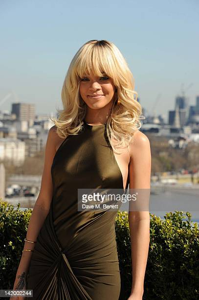 Rihanna poses as she attends the photocall for the movie 'Battleship' at the Corinthia Hotel on March 28 2012 in London England