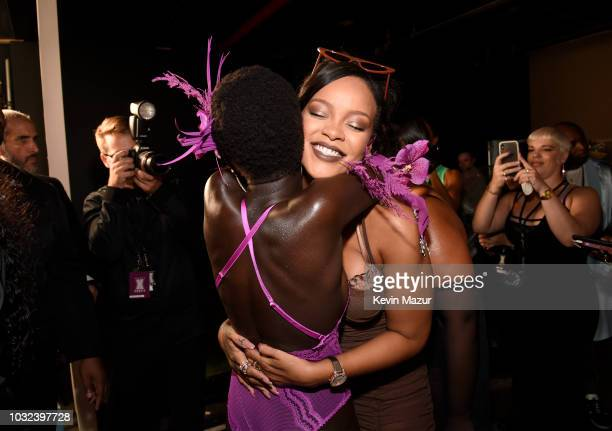 Rihanna poses backstage for the Savage X Fenty Fall/Winter 2018 fashion show during NYFW at the Brooklyn Navy Yard on September 12 2018 in Brooklyn NY