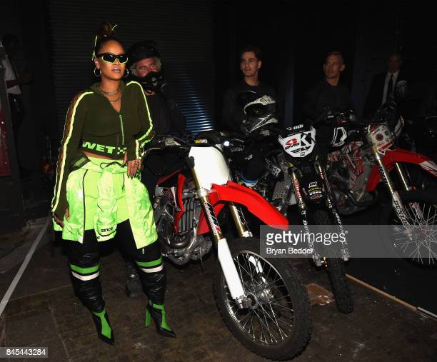 Rihanna poses backstage with motocross riders at the FENTY PUMA by Rihanna Spring/Summer 2018 Collection at Park Avenue Armory on September 10 2017...