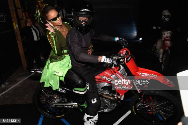 Rihanna poses backstage with motocross riders at the FENTY PUMA by Rihanna Spring/Summer 2018 Collection at Park Avenue Armory on September 10, 2017...