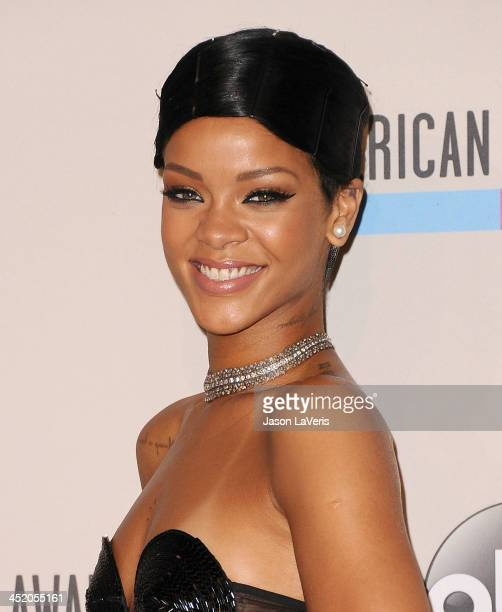 Rihanna poses in the press room at the 2013 American Music Awards at Nokia Theatre LA Live on November 24 2013 in Los Angeles California