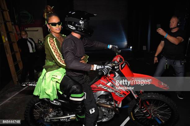 Rihanna poses on the back of a dirtbike backstage at the FENTY PUMA by Rihanna Spring/Summer 2018 Collection at Park Avenue Armory on September 10,...