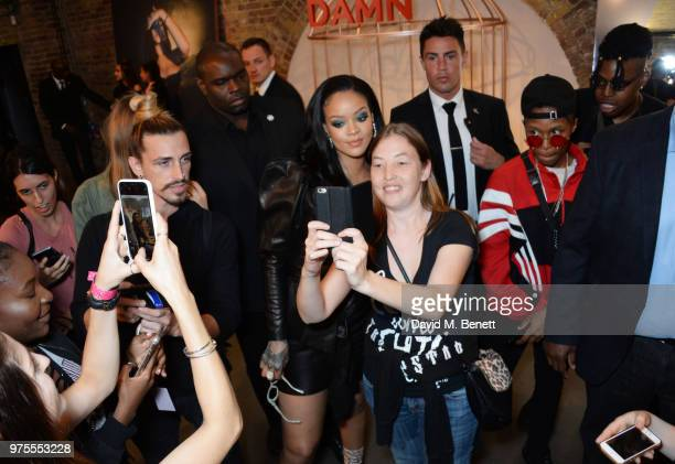Rihanna poses with fans at the Savage X Fenty London popup shop in  Shoreditch on June f0d4338438be