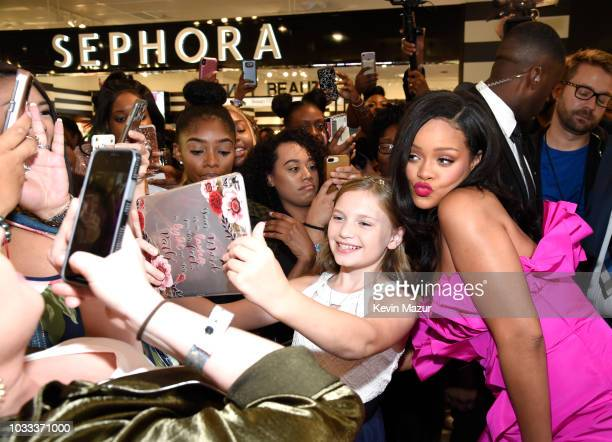 Rihanna poses with fans during Fenty Beauty's 1-year anniversary at Sephora inside JCPenney on September 14, 2018 in Brooklyn, New York.