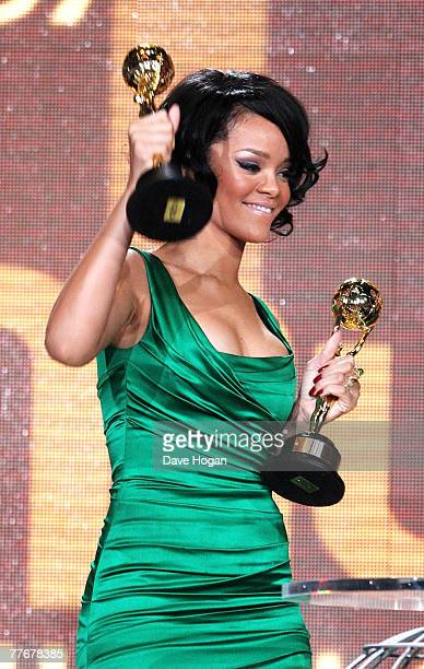Rihanna poses with the awards for World's Best Selling Female R&B Artist and World's Best Selling Pop Female Artist on stage at at the World Music...