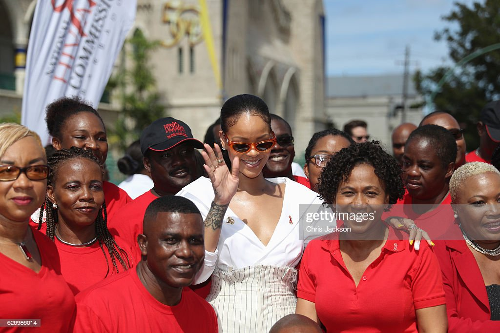 Rihanna poses with volunteers at the 'Man Aware' event held by the Barbados National HIV/AIDS Commission on the eleventh day of an official visit on December 1, 2016 in Bridgetown, Barbados. Prince Harry's visit to The Caribbean marks the 35th Anniversary of Independence in Antigua and Barbuda and the 50th Anniversary of Independence in Barbados and Guyana.