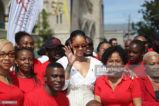 Rihanna poses with volunteers at the 'Man Aware' event held by the Barbados National HIV/AIDS Commission on the eleventh day of an official visit on...