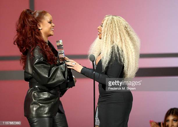 Rihanna presents the Lifetime Achievement Award to Mary J Blige onstage at the 2019 BET Awards at Microsoft Theater on June 23 2019 in Los Angeles...