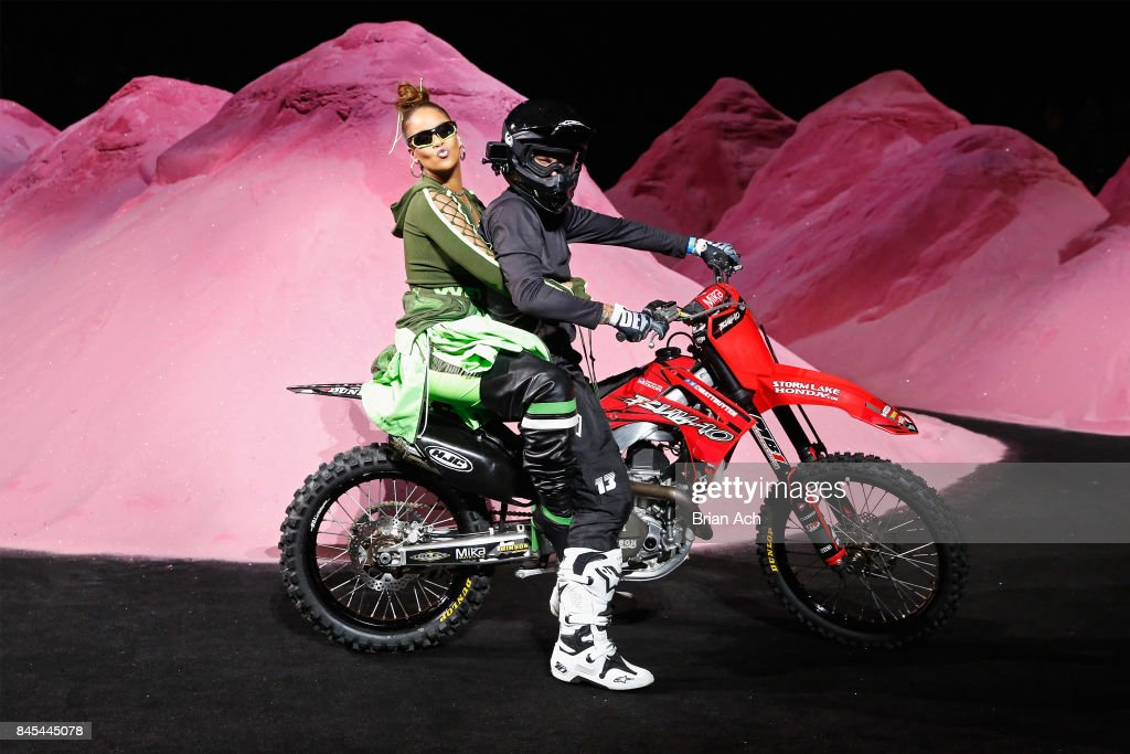 Rihanna rides a dirtbike on the runway at the FENTY PUMA by Rihanna Spring/Summer 2018 Collection at Park Avenue Armory on September 10, 2017 in New York City.