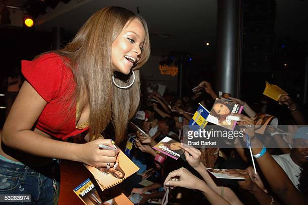 Rihanna signs autographs at the Shawn 'JayZ' Carter Hosts Teen People Listening Lounge at the Canal Room on July 20 2005 in New York City