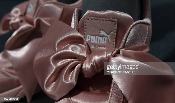 Rihanna sport shoes of German sportswear maker Puma are seen during the company's annual press conference on February 9 2017 in Herzogenaurach...