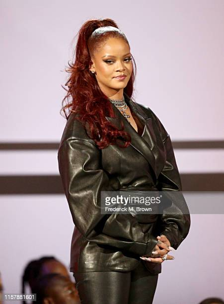 Rihanna stands onstage at the 2019 BET Awards at Microsoft Theater on June 23 2019 in Los Angeles California
