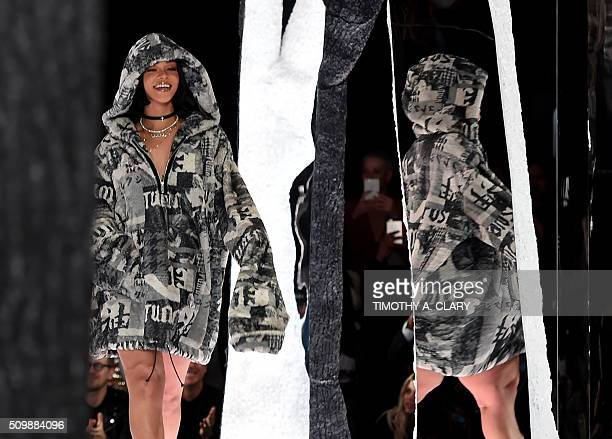 Rihanna takes a bow at the end of her show Fenty PUMA by Rihanna during the Fall 2016 New York Fashion Week in New York on February 12 2016 / AFP /...