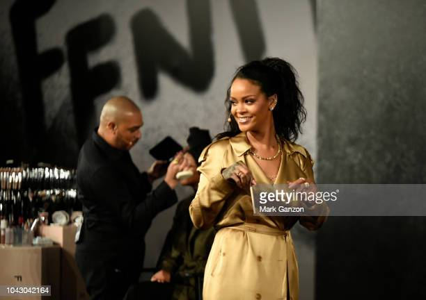 Rihanna walks on stage during her Fenty Beauty talk in collaboration with Sephora for the launch of her new Stunna Lip paint Uninvited on September...