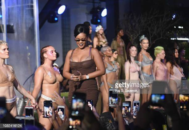 Rihanna walks the runway for the Savage X Fenty Fall/Winter 2018 fashion show during NYFW at the Brooklyn Navy Yard on September 12 2018 in Brooklyn...