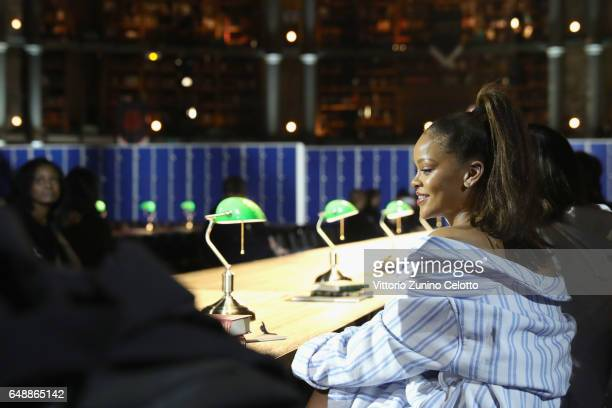 Rihanna watches a runthrough for FENTY PUMA by Rihanna Fall / Winter 2017 Collection at Bibliotheque Nationale de France on March 6 2017 in Paris...