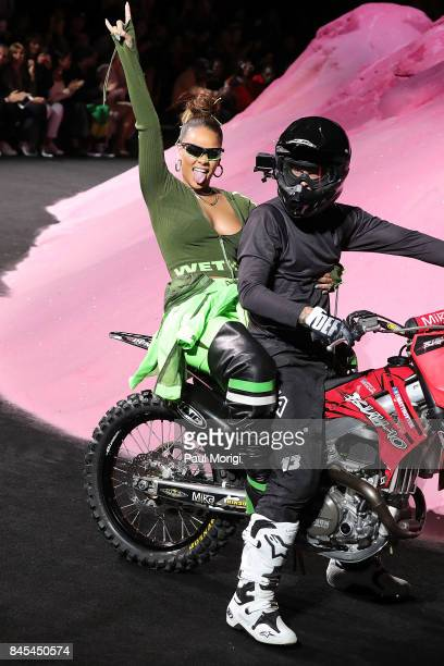Rihanna waves from the back of a motorcycle at the finale of the Fenty Puma by Rihanna show during New York Fashion Week at the 69th Regiment Armory...