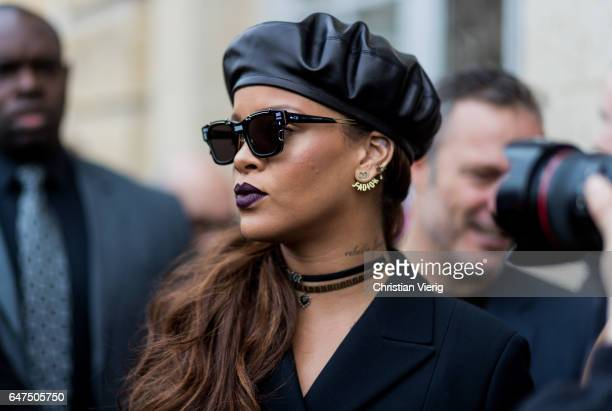 Rihanna wearing Dior sunglasses navy coat beret outside Dior on March 3 2017 in Paris France
