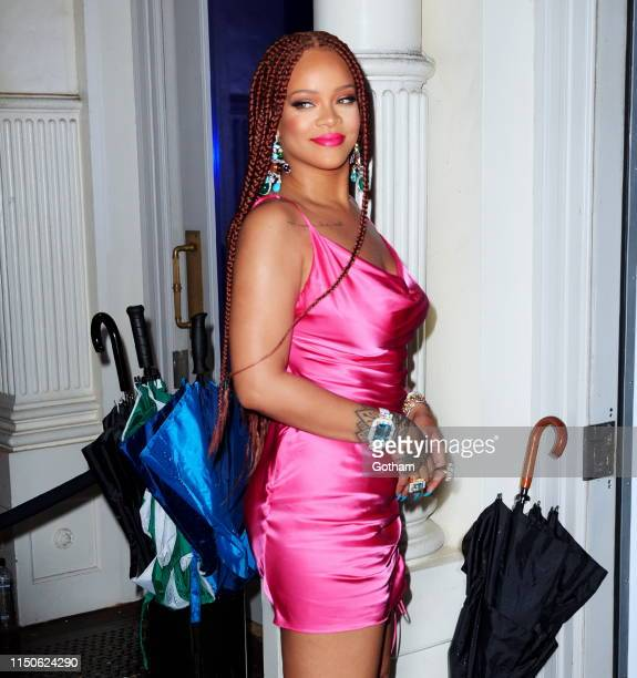 Rihanna wears a hot pink dress when arriving at a Fenty event on June 18 2019 in New York City
