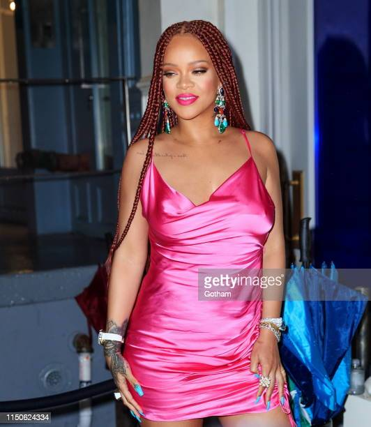 Rihanna wears a hot pink dress when arriving at a Fenty event on June 18, 2019 in New York City.