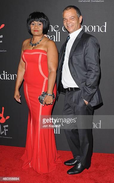 Rihanna's parents Monica Braithwaite and Ronald Fenty arrive at Rihanna's First Annual Diamond Ball at The Vineyard on December 11 2014 in Beverly...